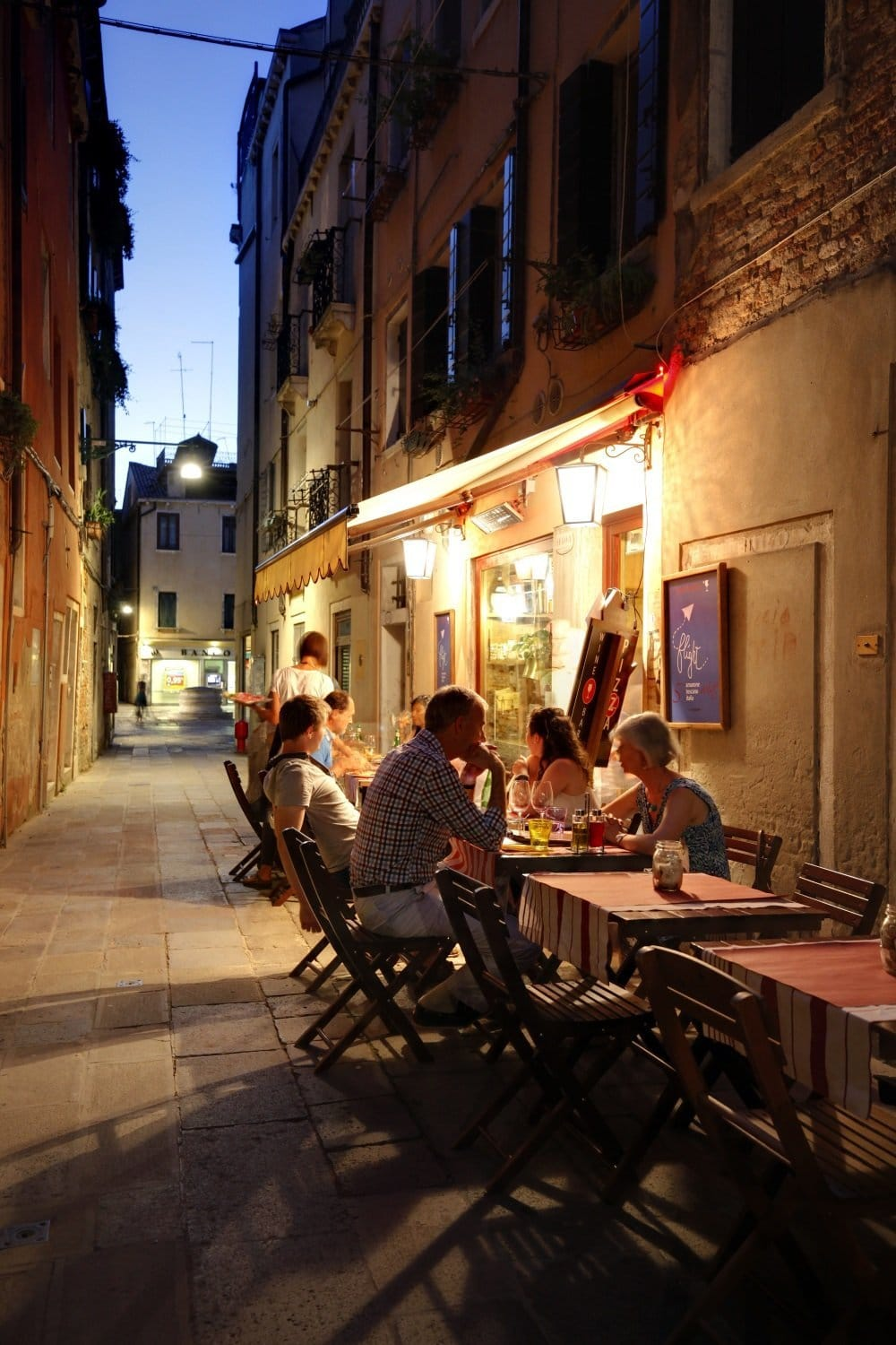 Tables outside in typical calle by night